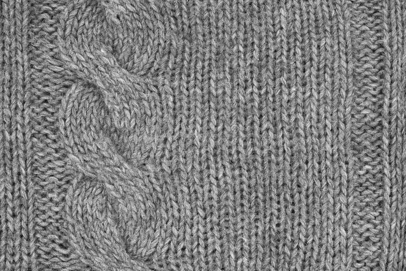 El gris hizo punto textura con un modelo de alivio Géneros de punto hechos a mano B fotos de archivo libres de regalías