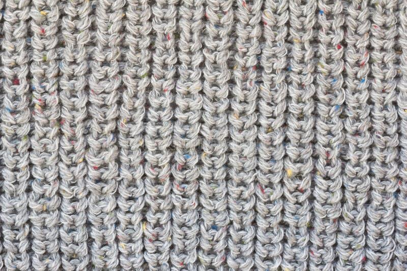 El gris hizo punto textura de la tela foto de archivo libre de regalías