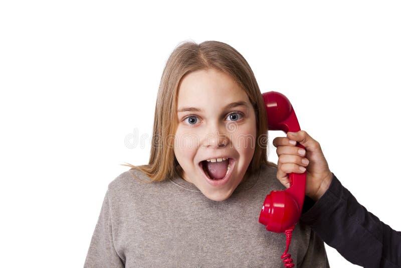 El hablar en el teléfono fotografía de archivo