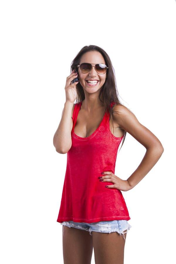 El hablar en el teléfono móvil imagen de archivo