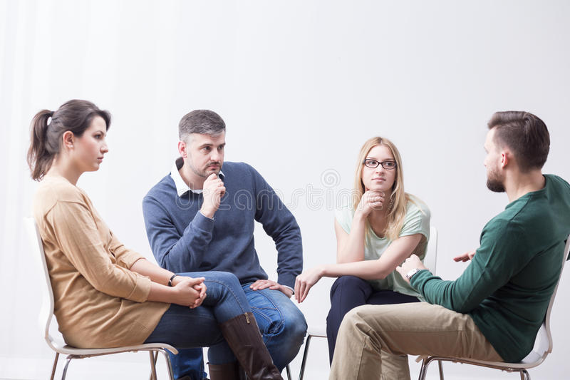 El hablar en grupo fotografía de archivo