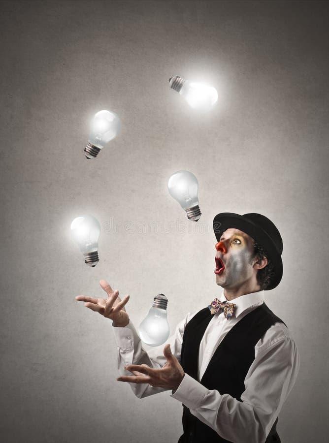 El hacer juegos malabares con las luces imagen de archivo libre de regalías
