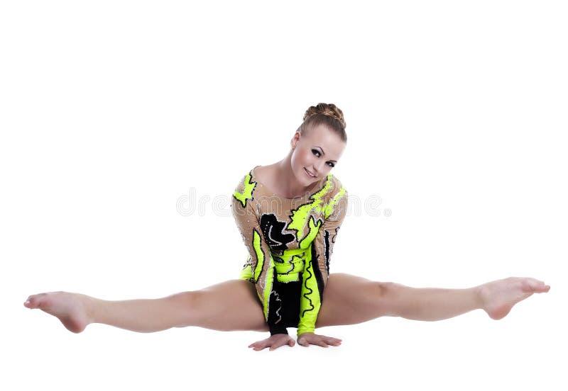 El hacer profesional joven del gimnasta las fracturas aisló fotografía de archivo libre de regalías