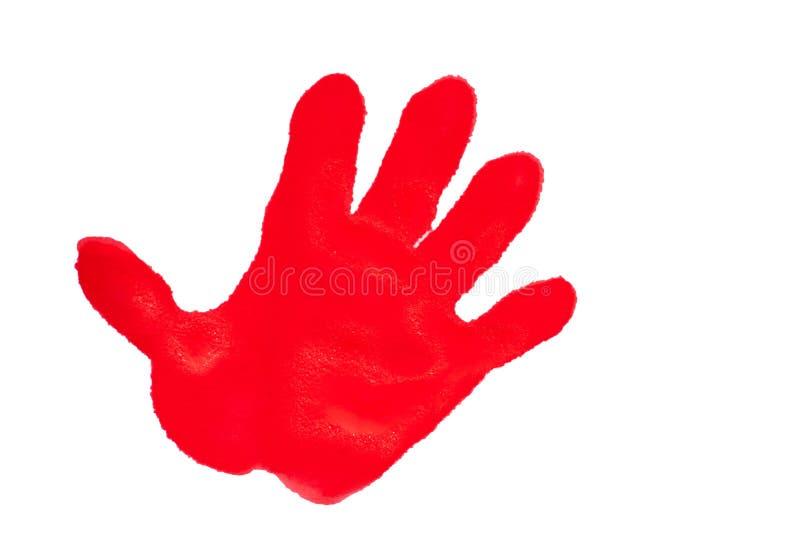 El handprint del niño con la pintura texturizada rojo fotos de archivo libres de regalías