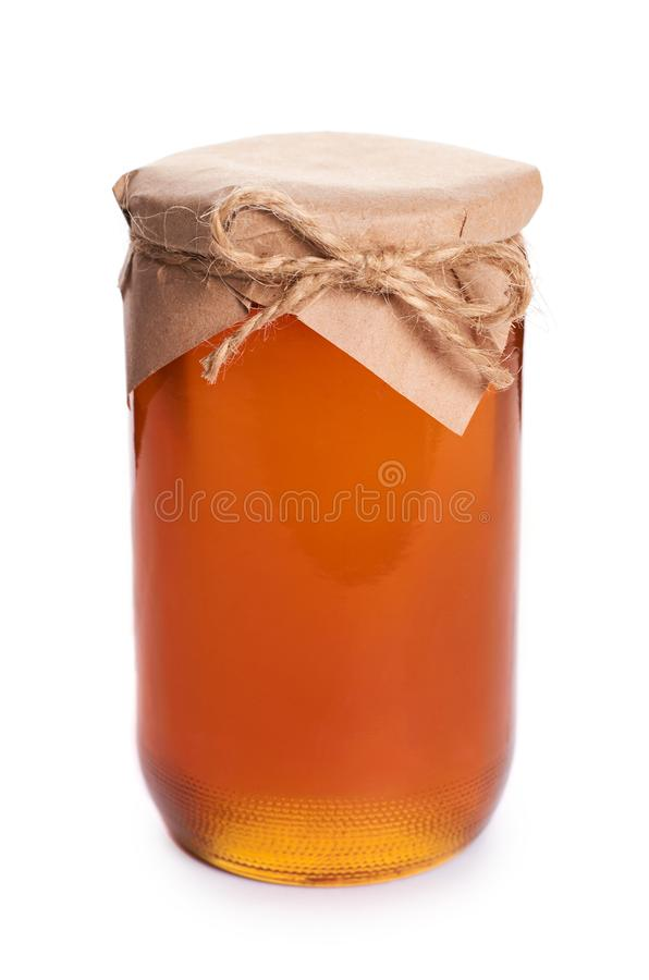 El hogar de Eco hizo la miel en el tarro aislado en el fondo blanco fotografía de archivo