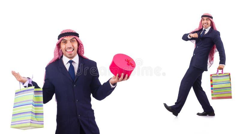 El hombre árabe con los regalos de las compras en blanco fotos de archivo