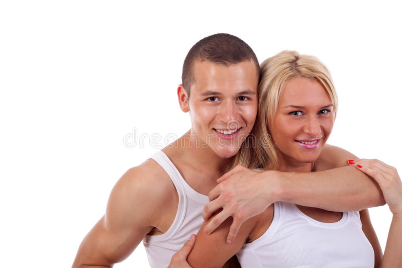 El hombre abraza a la muchacha imagenes de archivo