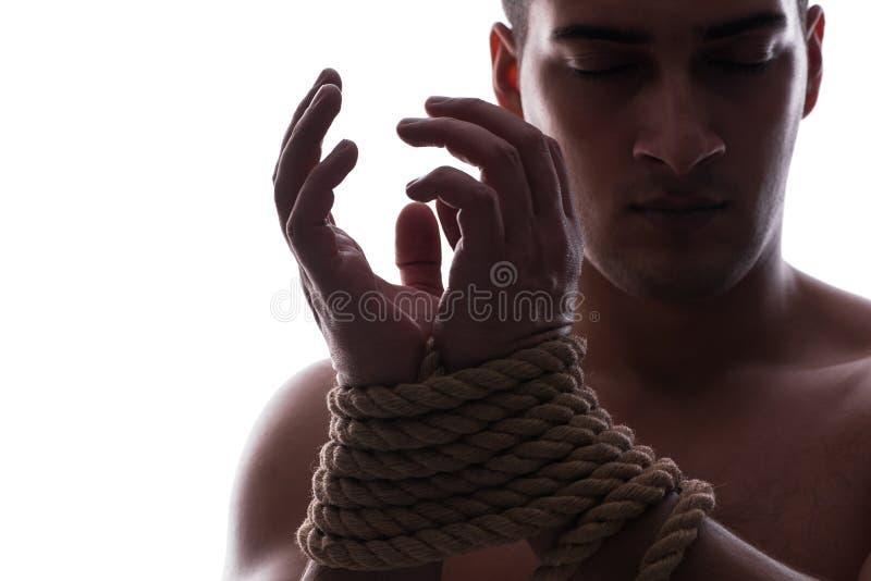 El hombre atractivo con las manos atadas fotografía de archivo