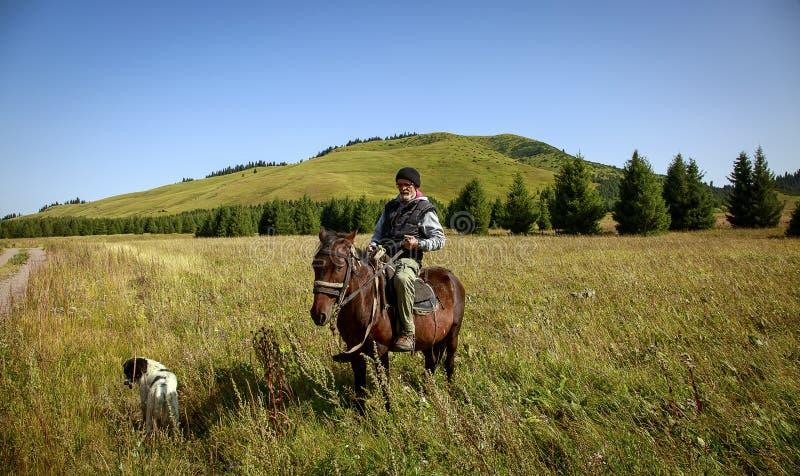 El hombre a caballo imagen de archivo