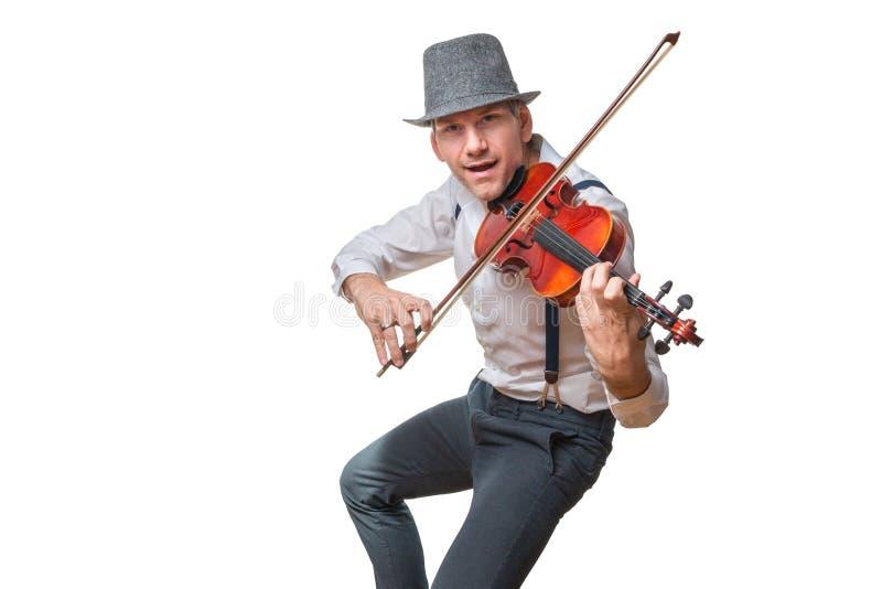 El hombre canta y toca el violín fotografía de archivo