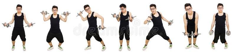 El hombre con pesas de gimnasia fotos de archivo