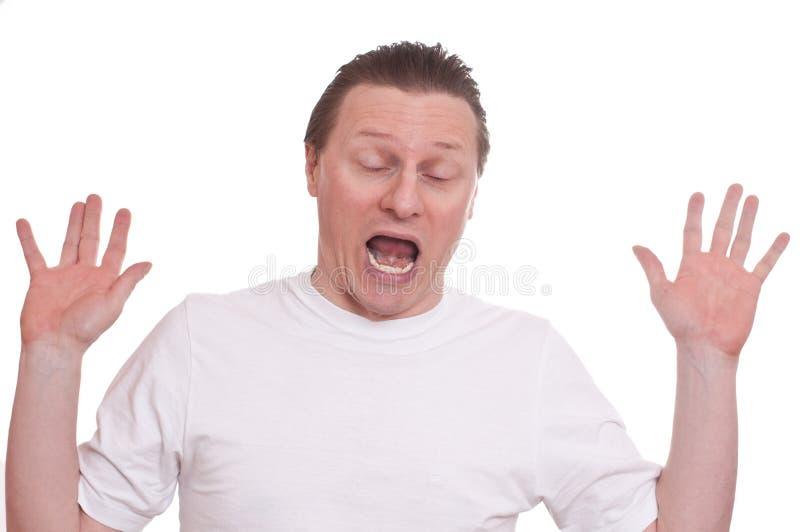 El hombre con susto está gritando fotografía de archivo libre de regalías