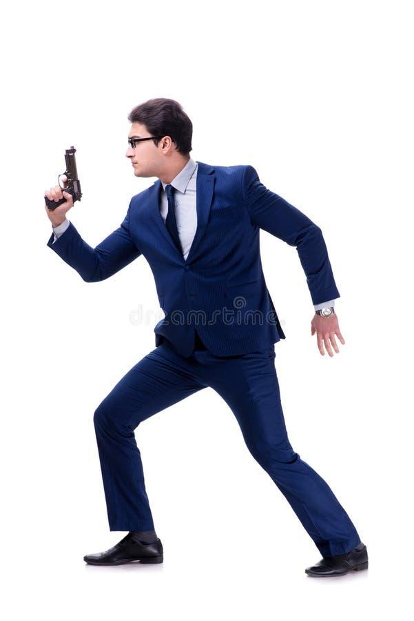 El hombre de negocios con el arma aislado en el fondo blanco foto de archivo