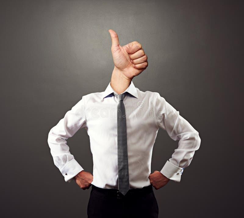 El hombre de negocios con los pulgares sube gesto foto de archivo libre de regalías