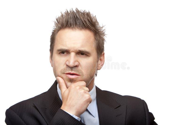 El hombre de negocios contemplativo piensa en problema imagenes de archivo