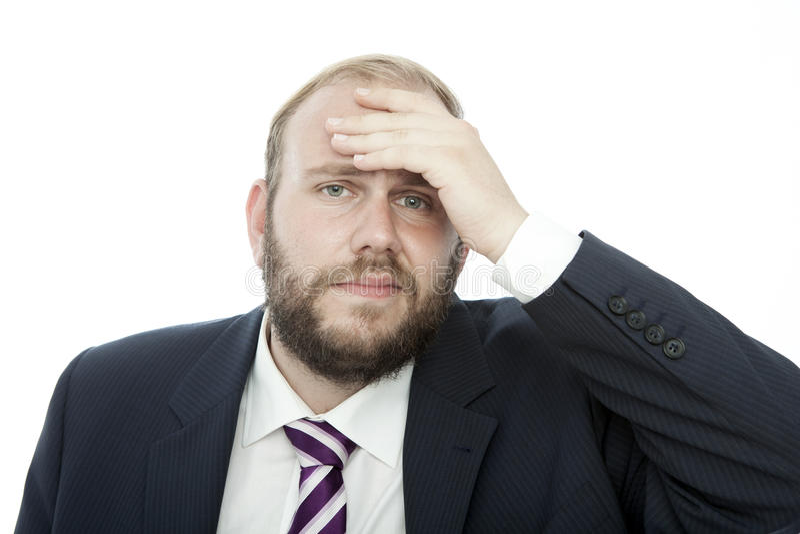 El hombre de negocios de la barba con la mano en la pista es enfermo foto de archivo libre de regalías