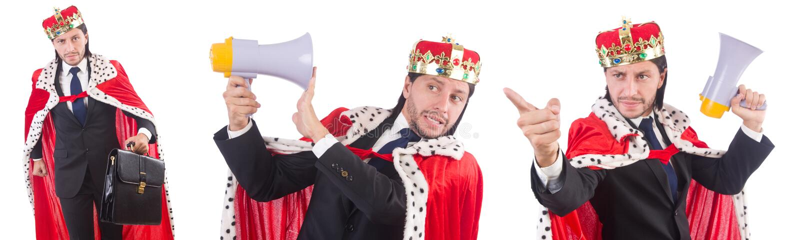 El hombre de negocios del rey con el altavoz aislado en blanco imagenes de archivo