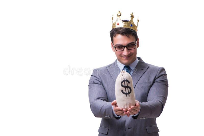 El hombre de negocios del rey que sostiene el bolso del dinero aislado en el fondo blanco foto de archivo