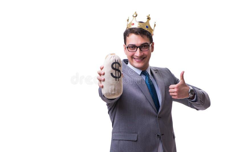 El hombre de negocios del rey que sostiene el bolso del dinero aislado en el fondo blanco imagen de archivo libre de regalías