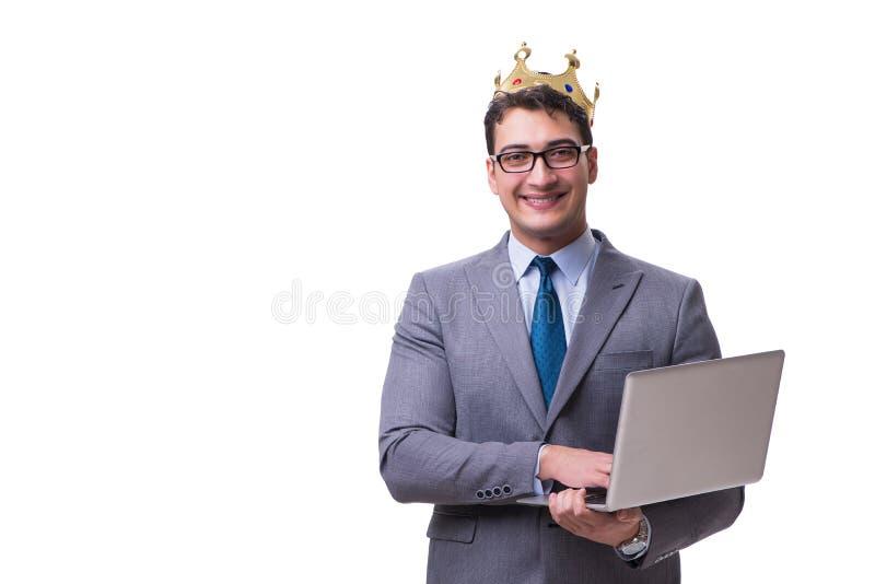 El hombre de negocios del rey que sostiene un ordenador portátil aislado en el fondo blanco imagen de archivo libre de regalías