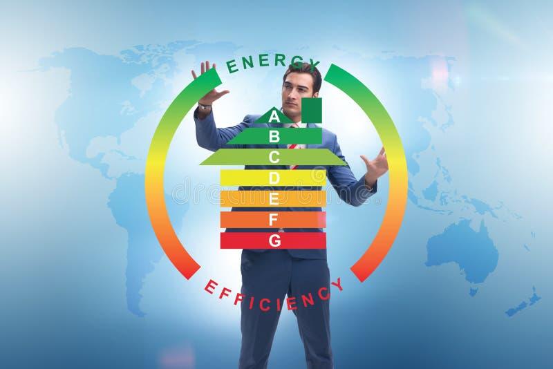 El hombre de negocios en concepto del rendimiento energético fotos de archivo