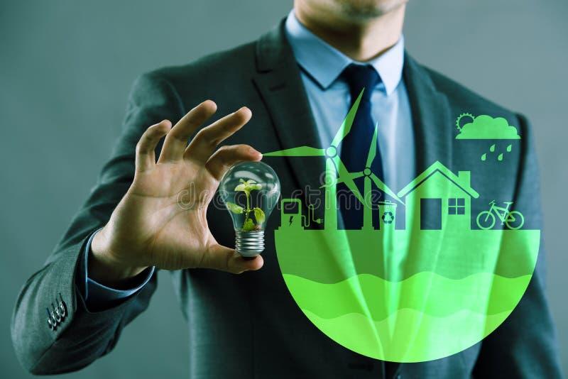 El hombre de negocios en concepto verde ecológico stock de ilustración
