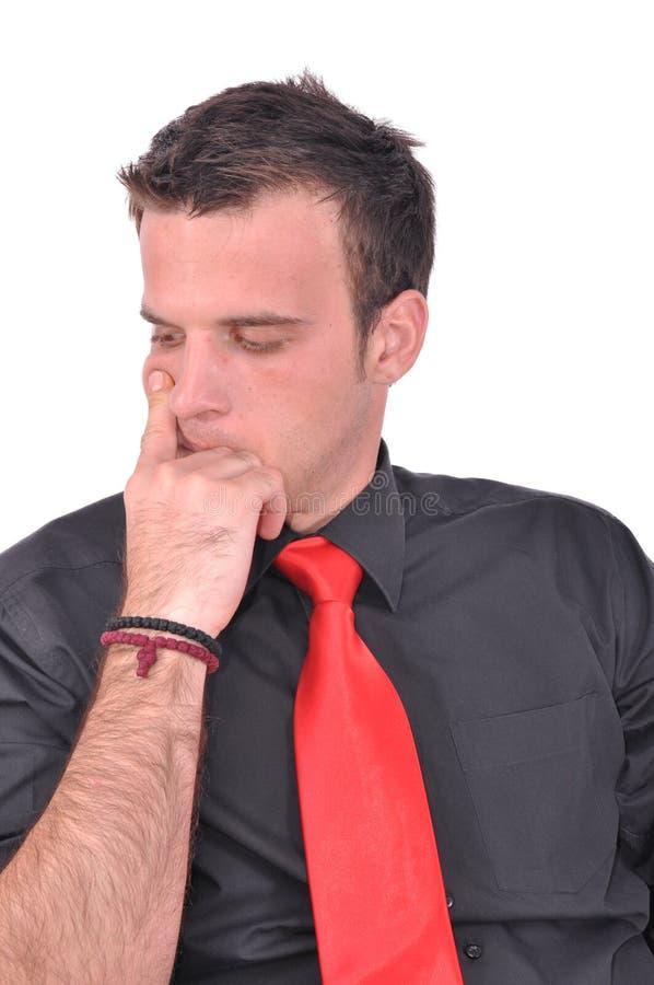 El hombre de negocios en cuestión está pensando imagen de archivo libre de regalías