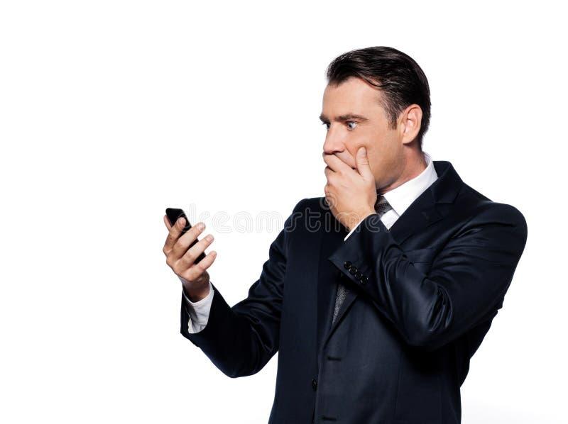 El hombre de negocios en el teléfono dio una sacudida eléctrica foto de archivo libre de regalías