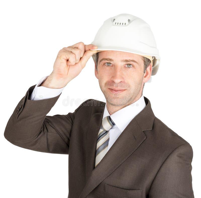 El hombre de negocios en traje aumentó su casco para saludar fotografía de archivo libre de regalías