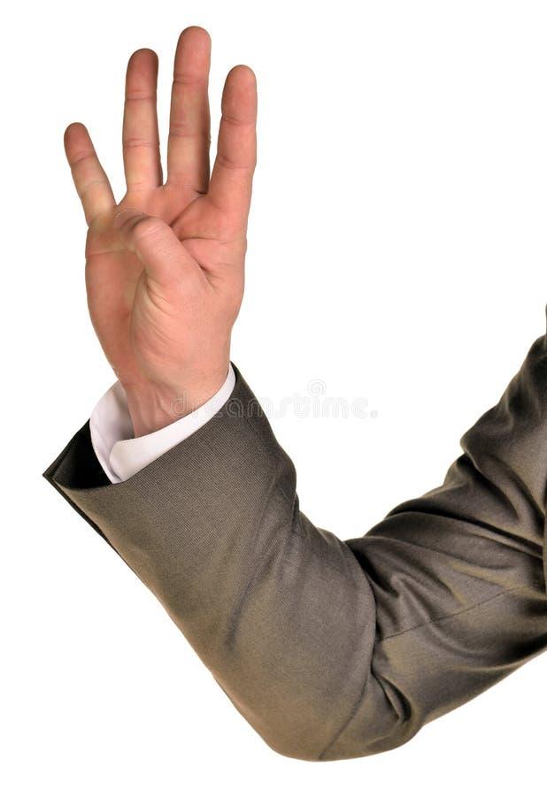 El hombre de negocios en traje muestra cuatro fingeres imagen de archivo libre de regalías