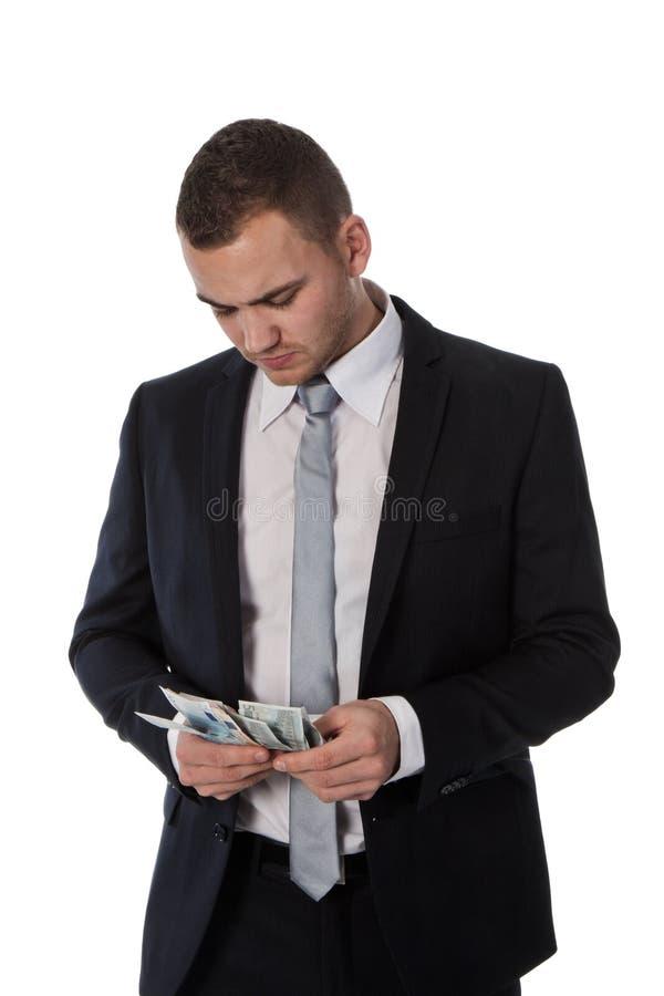 El hombre de negocios está contando el dinero fotos de archivo libres de regalías