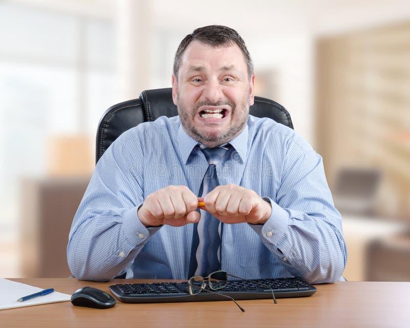 El hombre de negocios está realmente enojado imagen de archivo