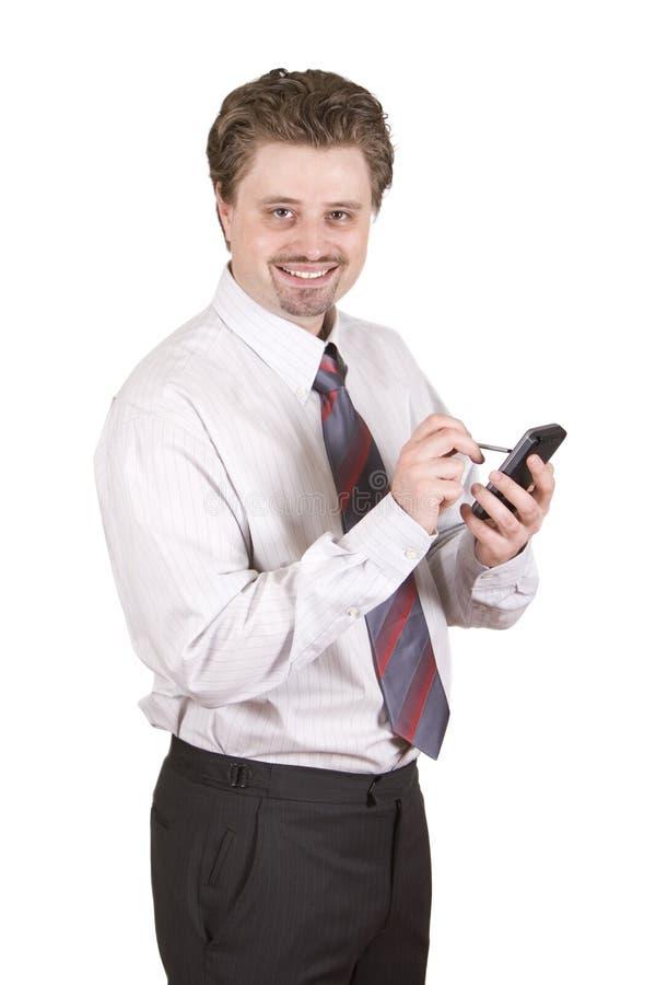El hombre de negocios está trabajando en PDA foto de archivo