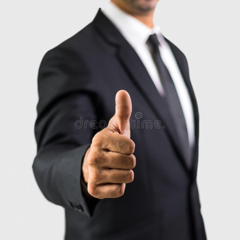 El hombre de negocios feliz con los pulgares sube gesto imagen de archivo libre de regalías