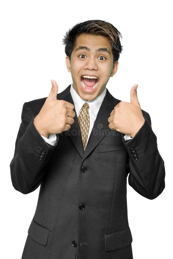 El hombre de negocios indio joven da los pulgares para arriba fotos de archivo