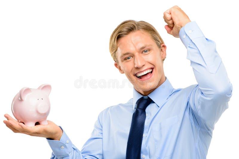 El hombre de negocios joven confiado que lleva a cabo el piggybank es aislador acertado fotografía de archivo libre de regalías