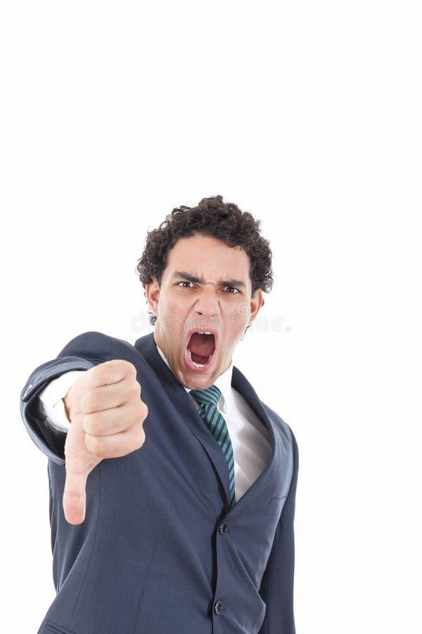 El hombre de negocios joven decepcionado que muestra el pulgar abajo firma fotografía de archivo
