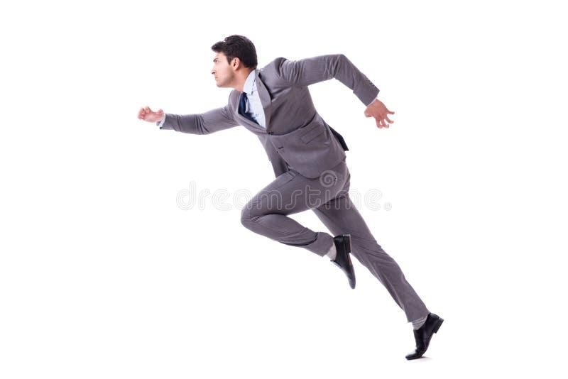 El hombre de negocios joven que corre adelante aislado en blanco foto de archivo
