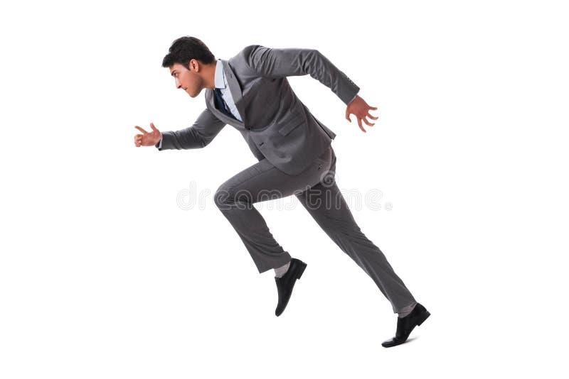 El hombre de negocios joven que corre adelante aislado en blanco fotos de archivo