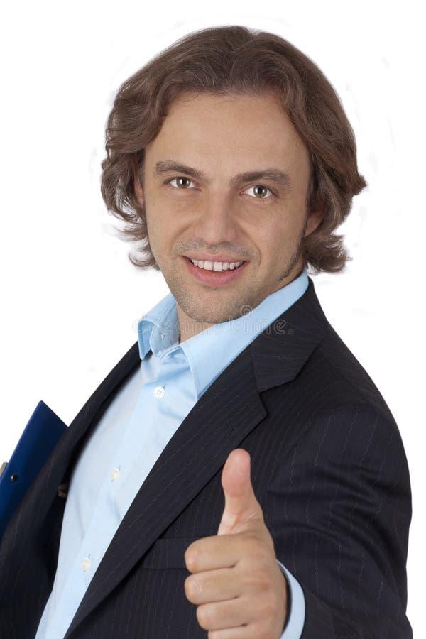 El hombre de negocios le da los pulgares para arriba fotografía de archivo libre de regalías