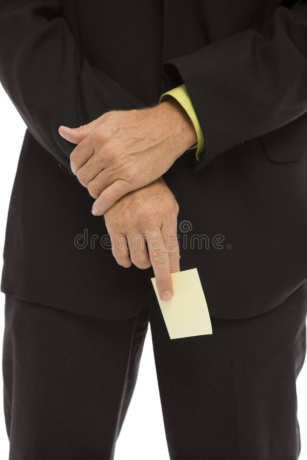 El hombre de negocios lleva a cabo una nota imagen de archivo