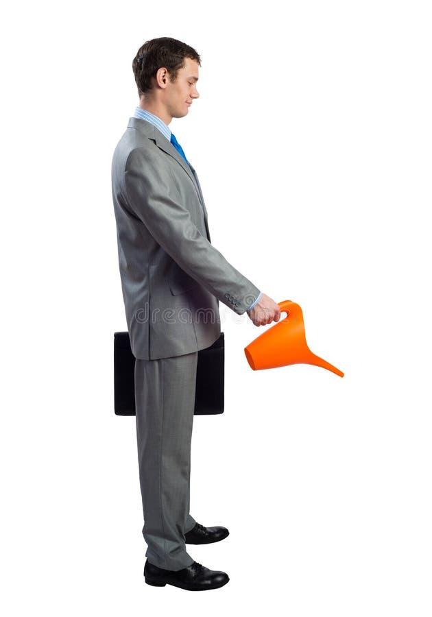 El hombre de negocios lleva el traje gris y el lazo azul fotos de archivo libres de regalías