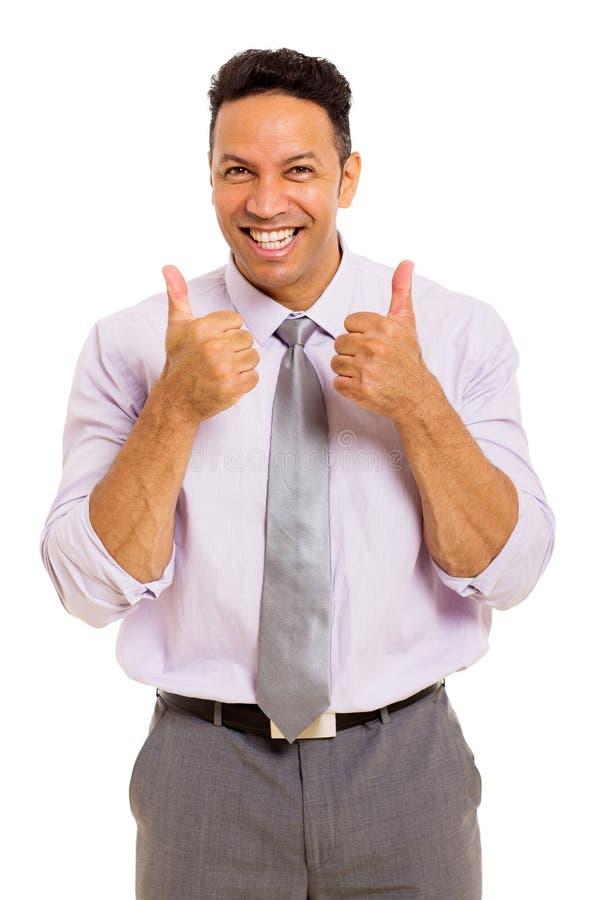 El hombre de negocios manosea con los dedos para arriba fotografía de archivo libre de regalías