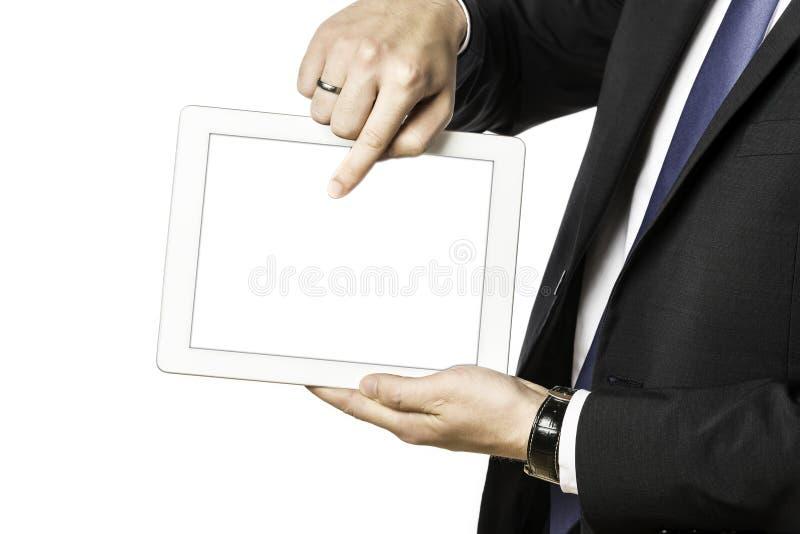 El hombre de negocios muestra algo en su ordenador de la tableta imágenes de archivo libres de regalías