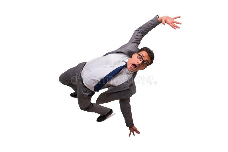 El hombre de negocios que cae aislado en el fondo blanco fotografía de archivo