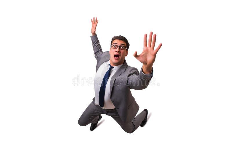 El hombre de negocios que cae aislado en el fondo blanco imagen de archivo
