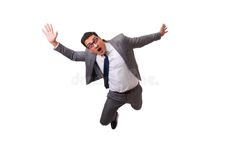 El hombre de negocios que cae aislado en el fondo blanco imágenes de archivo libres de regalías
