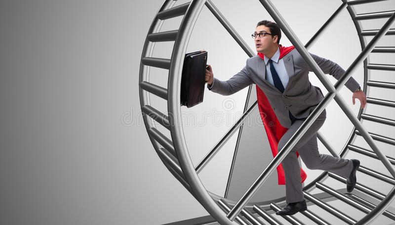 El hombre de negocios que corre en la rueda del hámster foto de archivo
