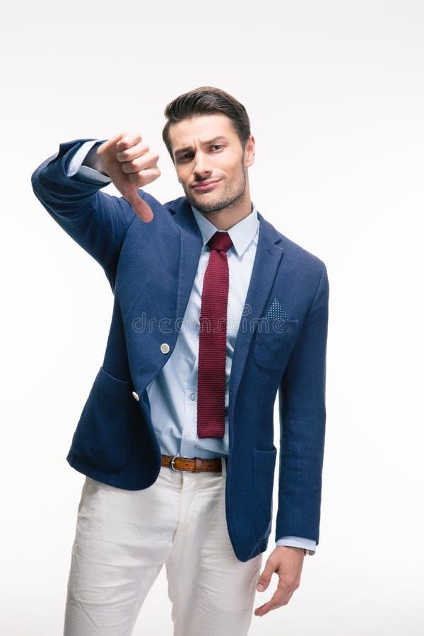 El hombre de negocios que muestra el pulgar abajo firma imágenes de archivo libres de regalías