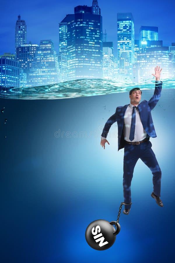 El hombre de negocios que se ahoga bajo carga del pecado y de la culpabilidad fotografía de archivo libre de regalías